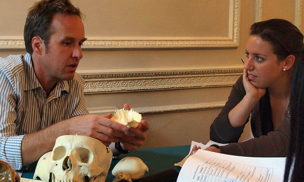 Tutor explaining skull bones