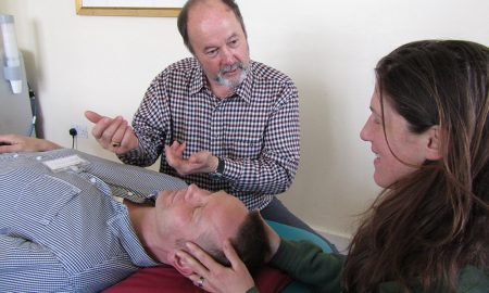 Tutor guiding an osteopath