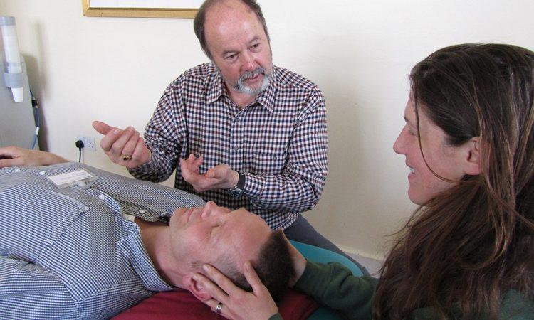 Tutor guiding an osteopath