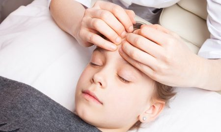 Young girl receiving osteopathic treatment