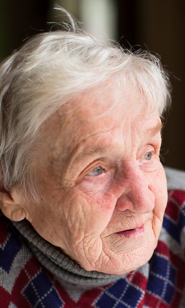 Older person looking out the window